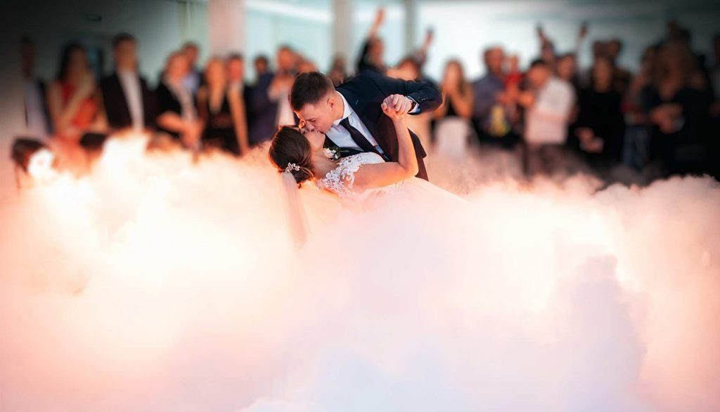 Bride & Groom dancing on a cloud