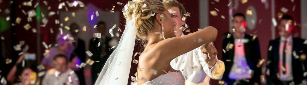 Bride & Groom Dancing under confetti